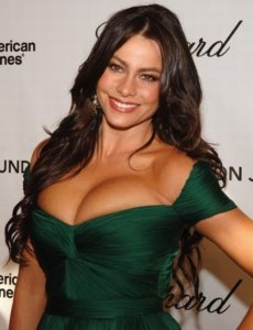 Sofia Vergara with a lovely smile in a dark green dress