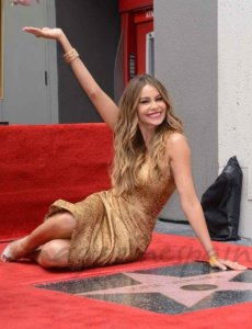 Sofia Vergara posing with her star in the Hollywood Hall of Fame