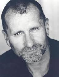 Youger Ed O'Neill looking great in a black and white photo