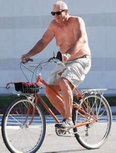 Ed O'Neill shirtless in a bike