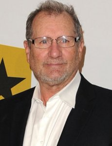 Ed O'Neill posing for a photo with glasses