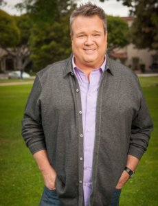 Eric Stonestreet body photo smiling with a casual outfit