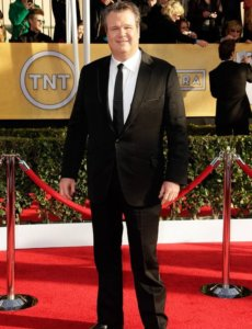 Full body image of Eric Stonestreet wearing a smoking
