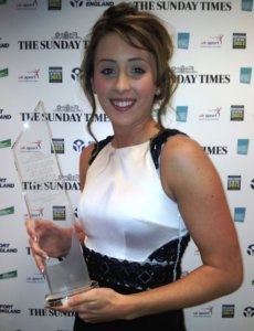 Jade Jones holding an award