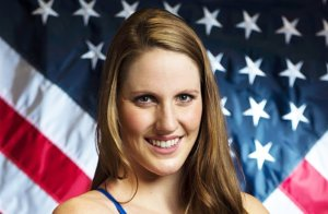 Missy Franklin smiling with the american flag behind