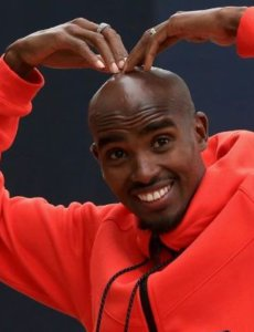 Mo Farah doing the mobot in a casual outfit