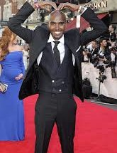 Mo Farah doing the mobot in a suit
