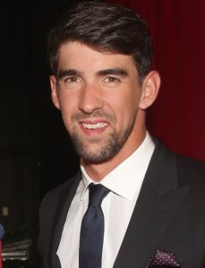 Michael Phelps smiling in a suit