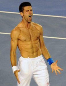 Shirtless image of Novak Djokovic showing his abs where it's possible to check his weight