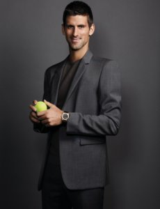 Novak Djokovic looking handsome in a grey suit and shirt
