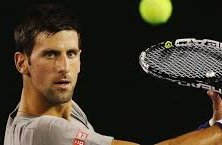 Novak Djokovic playing a tennis match really focused