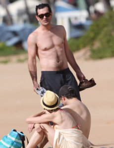 Ty Burrell body shirtless in a beach with sunglasses showing his fit body