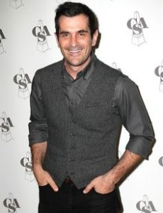 Ty Burrell smiling in a photo shoot