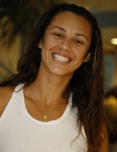Talita Antunes smiling in a white shirt